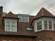 Approved: replacement uPVC windows at a flat in Bournemouth conservation area