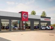 Approved: external alterations and advertisement consent at car show room in Dorchester