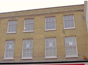 Listed building shop front approved planning consultant Winchester