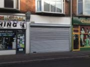Approved: roller shutter on shop in Pokesdown resolving enforcement issue