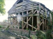 Demolition and replacement of barn in curtilage of Listed Building in South Downs National Park